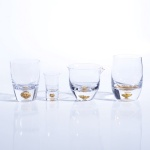 clear glass cup with golden foil bottom hole